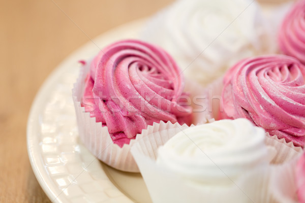 close up of zephyr or marshmallow dessert on plate Stock photo © dolgachov