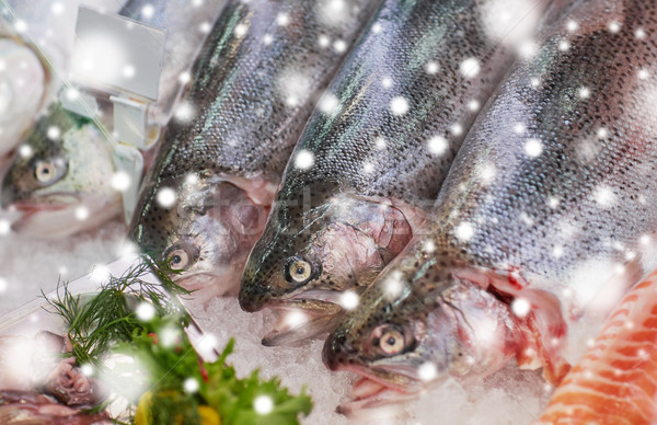 fresh fish on ice at grocery stall Stock photo © dolgachov