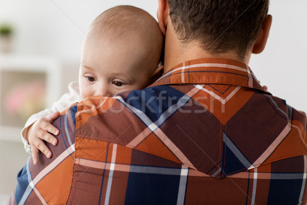 close up of happy little baby boy with father Stock photo © dolgachov