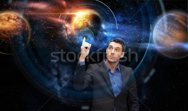 businessman with virtual planets and space Stock photo © dolgachov