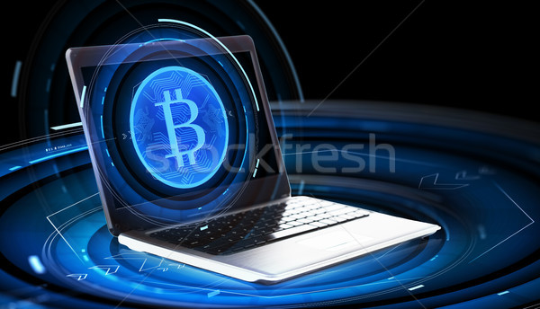 laptop computer with bitcoin hologram Stock photo © dolgachov