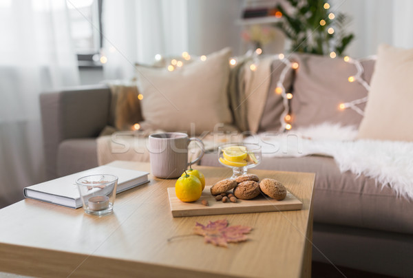 oat cookies, book, tea and lemon on table at home Stock photo © dolgachov