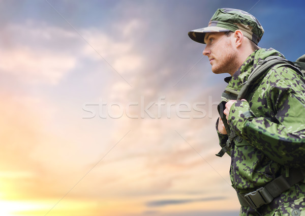 soldier in military uniform with backpack hiking Stock photo © dolgachov