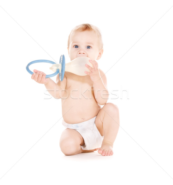 baby boy with big pacifier Stock photo © dolgachov