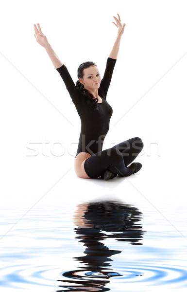 fitness in black leotard on white sand Stock photo © dolgachov