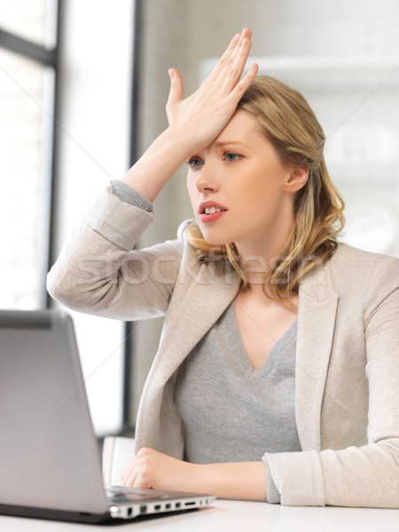 Stock photo: stressed woman with laptop computer
