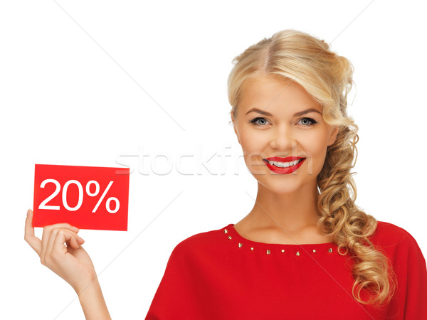 lovely woman in red dress with discount card Stock photo © dolgachov