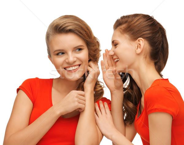 two talking teenage girls in red t-shirts Stock photo © dolgachov