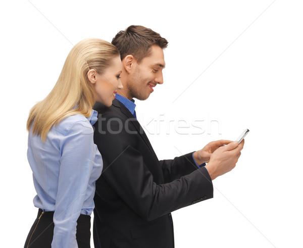 man and woman reading sms Stock photo © dolgachov