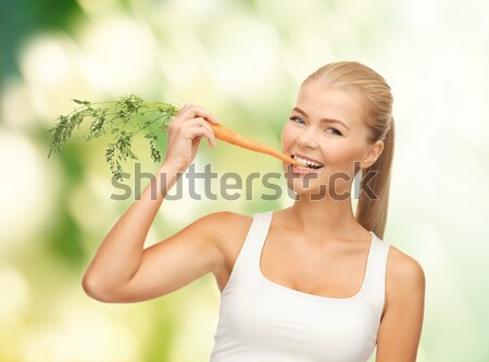 woman biting piece of celery or green salad Stock photo © dolgachov