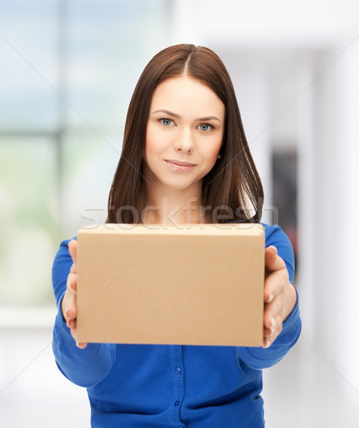 businesswoman delivering box Stock photo © dolgachov