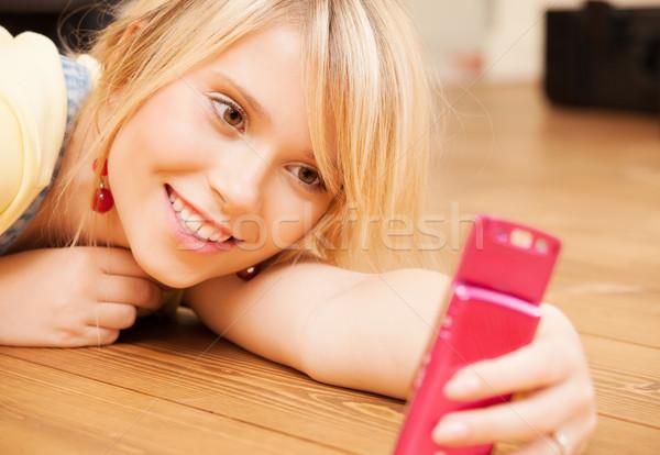 Autoritratto smartphone tecnologia donna Foto d'archivio © dolgachov