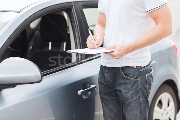 man with car documents Stock photo © dolgachov