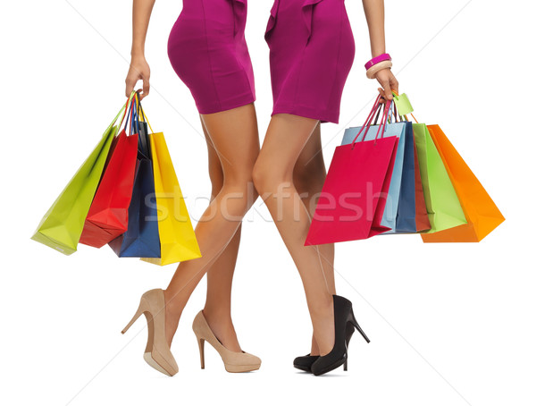 two women in pink dresses with shopping bags Stock photo © dolgachov