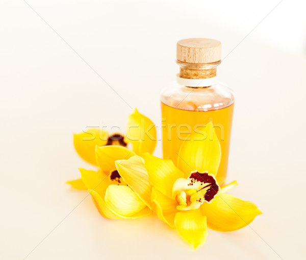 closeup of essential oil and orchid flowers Stock photo © dolgachov