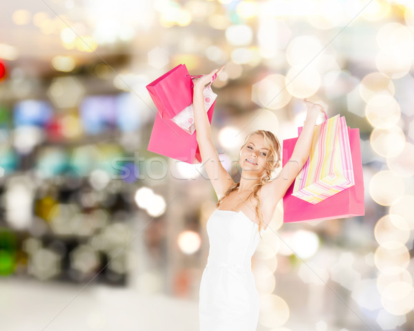 woman with shopping bags in dress Stock photo © dolgachov