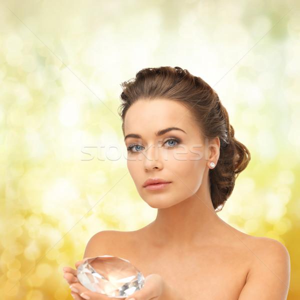 woman showing big diamond Stock photo © dolgachov