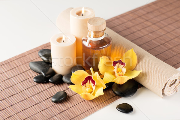 essential oil, massage stones and orchid flower Stock photo © dolgachov