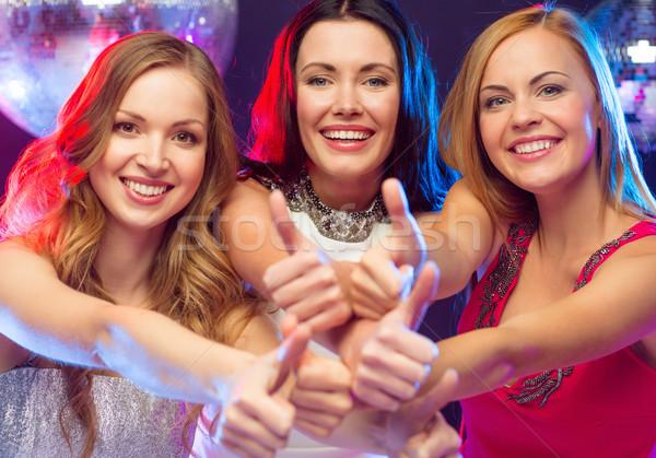 three women showing thumbs up Stock photo © dolgachov