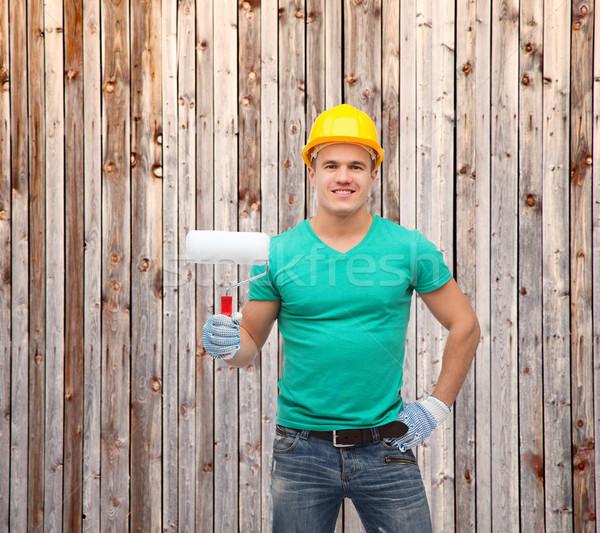 Sonriendo manual trabajador casco pintura reparación Foto stock © dolgachov