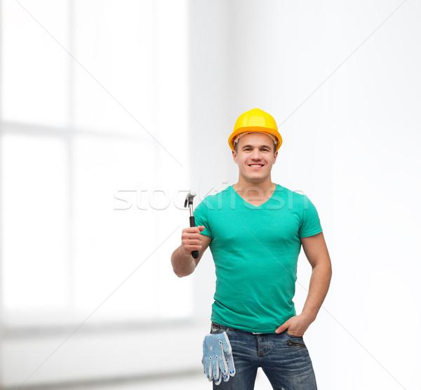 Sonriendo manual trabajador casco martillo reparación Foto stock © dolgachov