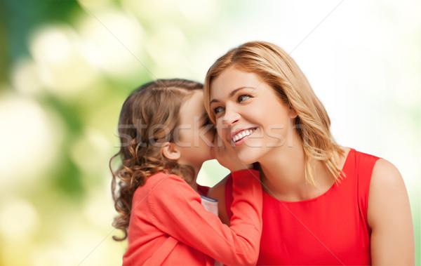 Souriant mère fille chuchotement potins famille Photo stock © dolgachov
