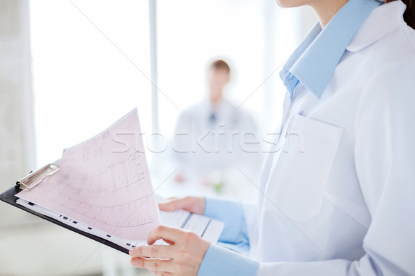 female holding clipboard with cardiogram Stock photo © dolgachov