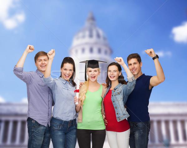Grup ayakta gülen Öğrenciler diploma eğitim Stok fotoğraf © dolgachov