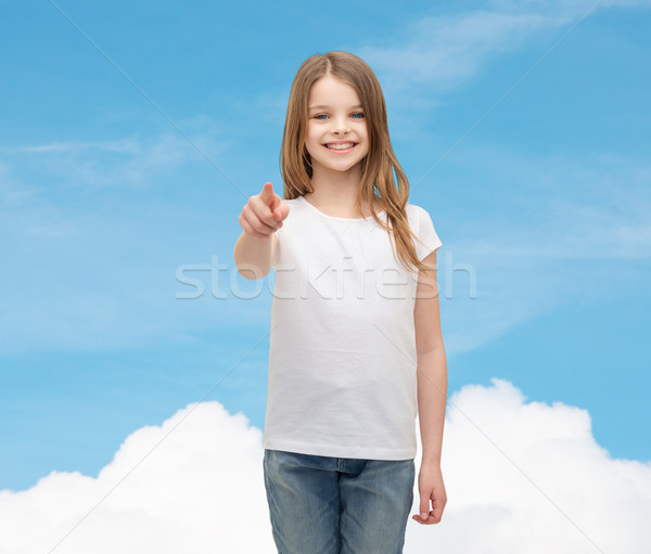 little girl in blank white t-shirt pointing at you Stock photo © dolgachov