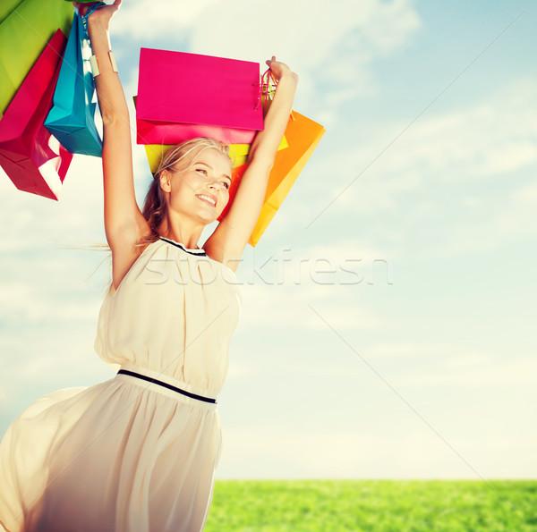 woman with shopping bags Stock photo © dolgachov