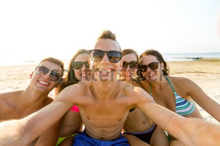 Stock photo: group of young smiling women making selfie