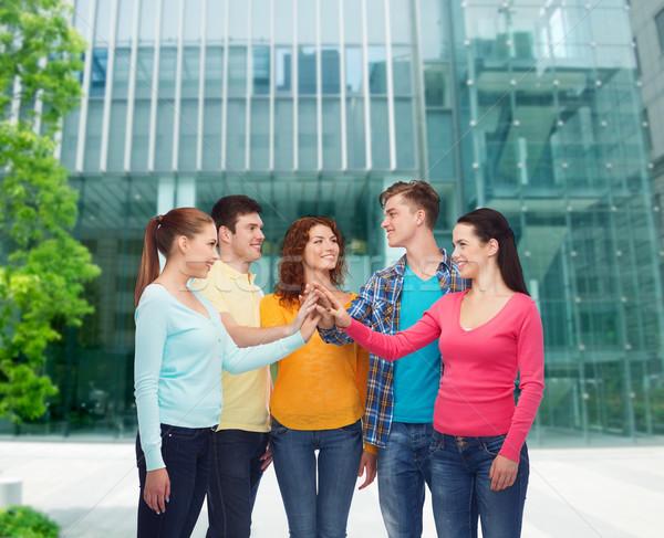 Glimlachend tieners high five vriendschap onderwijs Stockfoto © dolgachov