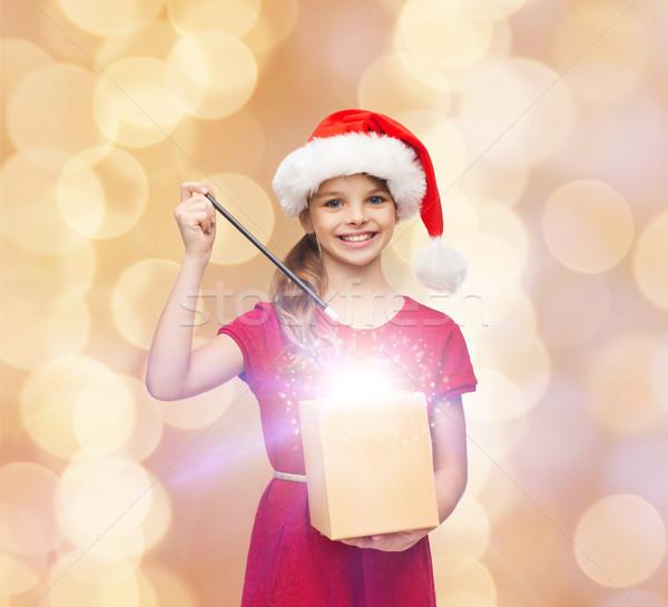 smiling girl in santa helper hat with gift box Stock photo © dolgachov