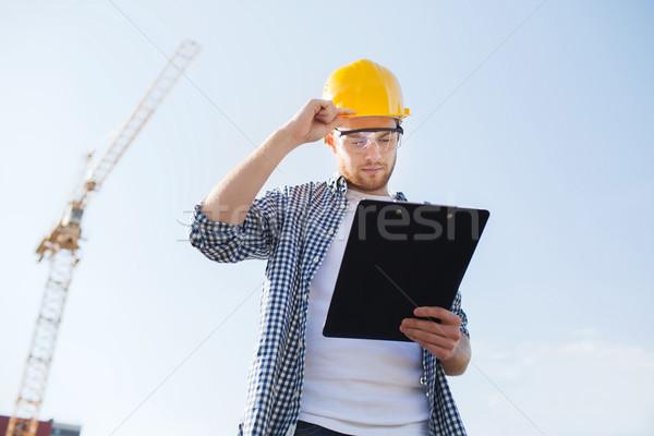 építész munkavédelmi sisak vágólap kint üzlet épület Stock fotó © dolgachov