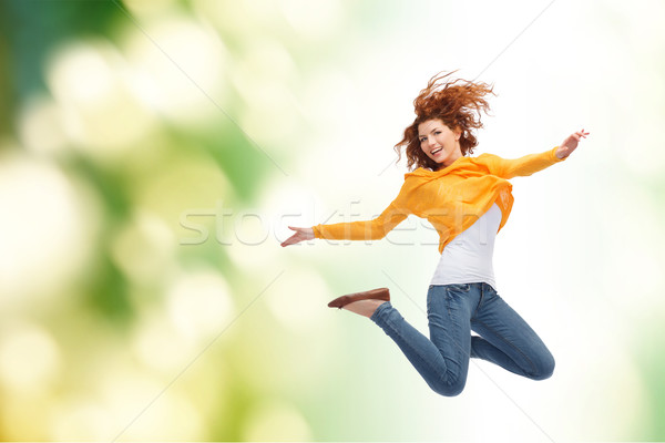 smiling young woman jumping high in air Stock photo © dolgachov
