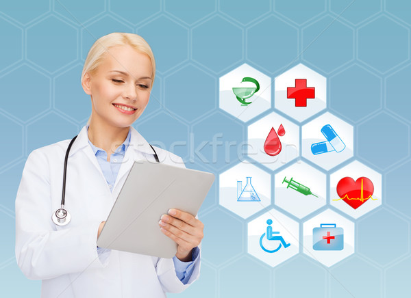 smiling doctor with tablet pc and medical symbols Stock photo © dolgachov
