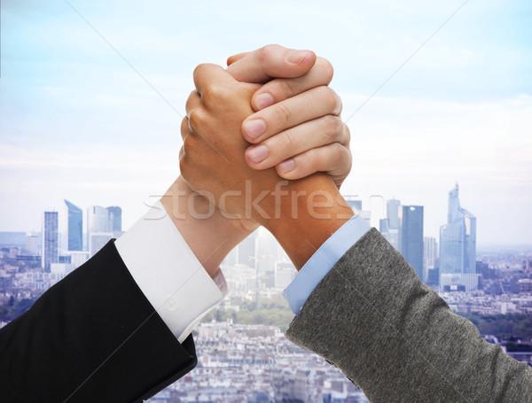 Handen arm worstelen stad business concurrentie Stockfoto © dolgachov