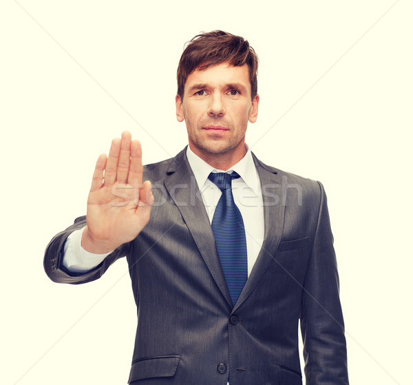 attractive buisnessman making stop gesture Stock photo © dolgachov