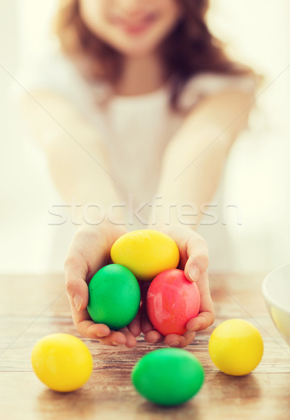 close up of girl holding colored eggs Stock photo © dolgachov