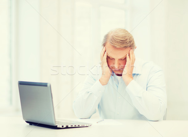 Stock photo: stressed old man filling a form at home