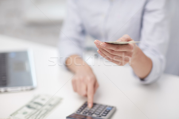 close up of woman counting money with calculator Stock photo © dolgachov
