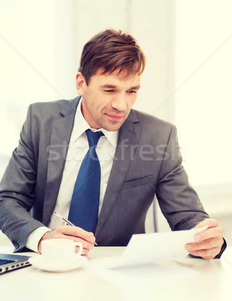 businessman with laptop computer and documents Stock photo © dolgachov