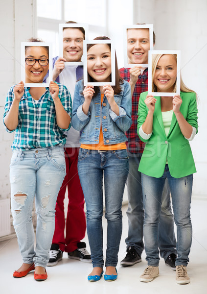 happy friends covering faces with own photos Stock photo © dolgachov