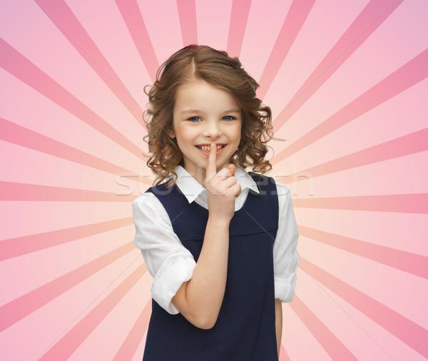happy girl showing hush gesture Stock photo © dolgachov