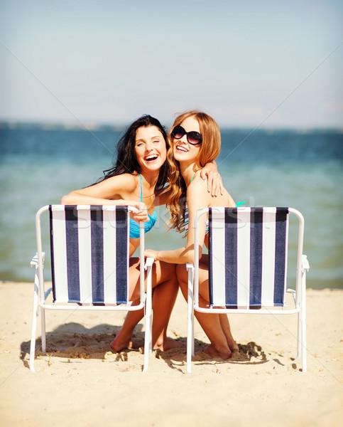 Ragazze prendere il sole estate vacanze vacanze Foto d'archivio © dolgachov