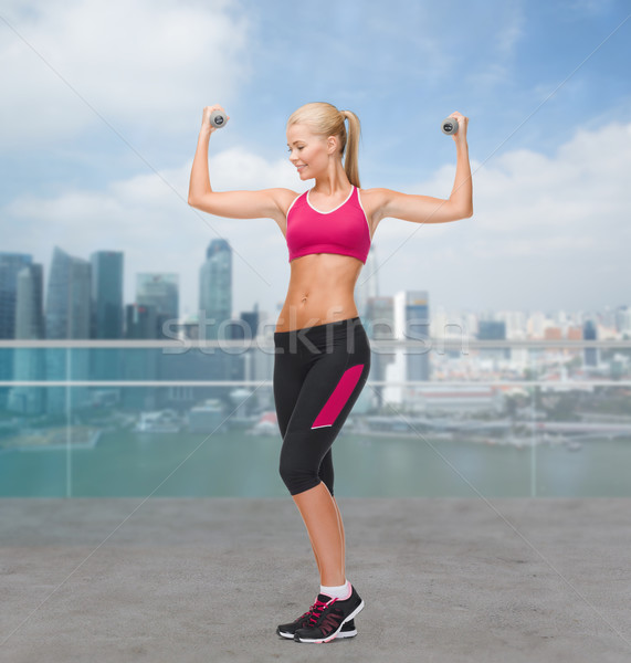 young sporty woman with dumbbells Stock photo © dolgachov