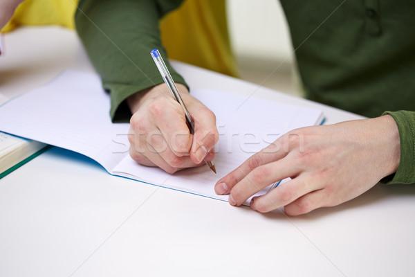 Zdjęcia stock: Mężczyzna · ręce · piśmie · notebooka · ludzi