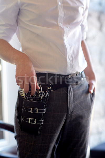 close up of male stylist with tool case at salon Stock photo © dolgachov