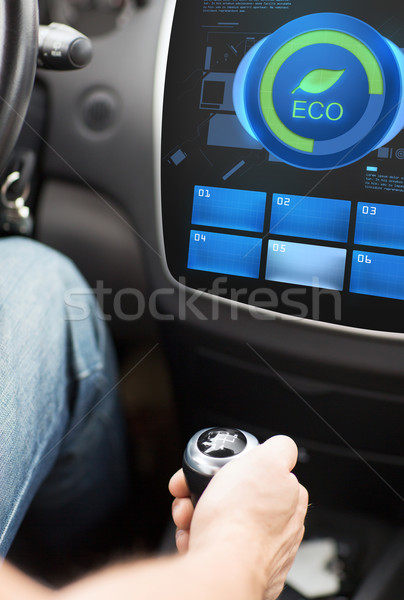 hand with gearshift and car eco mode on screen Stock photo © dolgachov