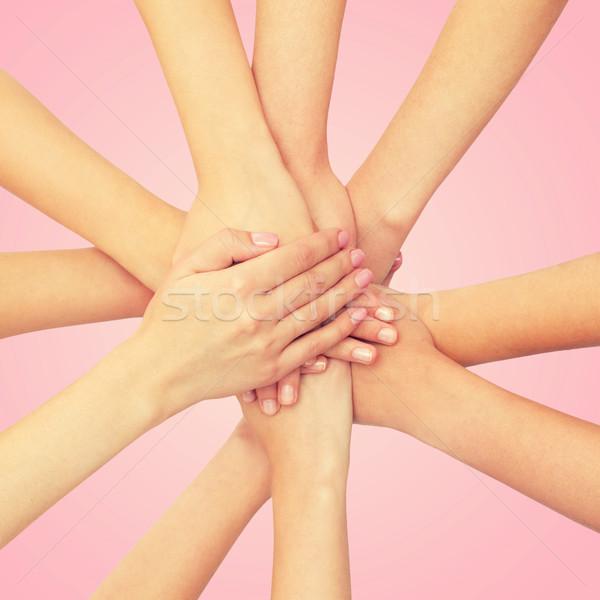 Donne mani top femminismo potere Foto d'archivio © dolgachov